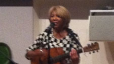 Linda Lewis playing guitar at the V & A